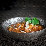 Indian pattern bowl with coconut milk butter chicken.