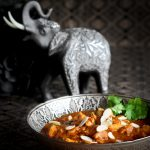 Elephant with decorative Indian bowl of paleo pressure cooker butter chicken.