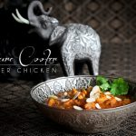 Instant Pot Butter Chicken in decorative bowl with silver elephant.
