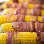 Sweet & savory, just the way you like it! https://www.theprimaldesire.com/bacon-wrapped-corn/