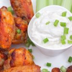Blue Cheese Yogurt Dressing with Actual Probiotic Yogurt plated with hot wings and celery