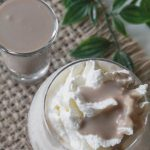 Coconut dairy free Irish cream shot and coconut whip cream.