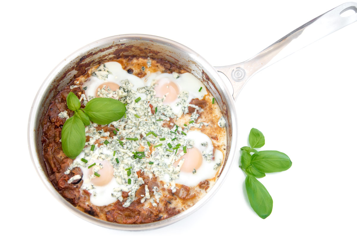 Pan of whore's Puttanesca Shakshuka with Blue Cheese
