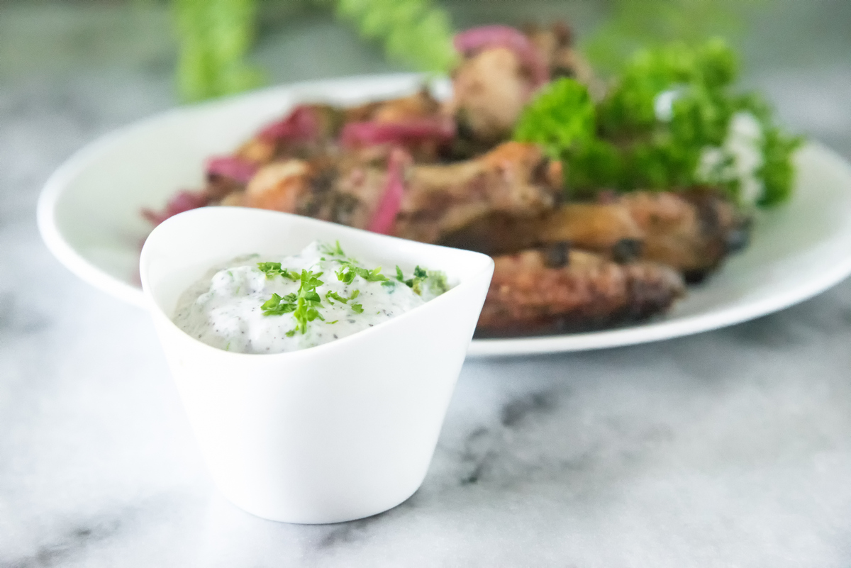 Dairy Free Tzatziki Sauce with Jalapeño is a fresh bright dip that pairs perfectly with Mediterranean dishes like braised lamb and sumac chicken wings. Jalapeño tzatziki sauce makes a great paleo & keto tzatziki twist!