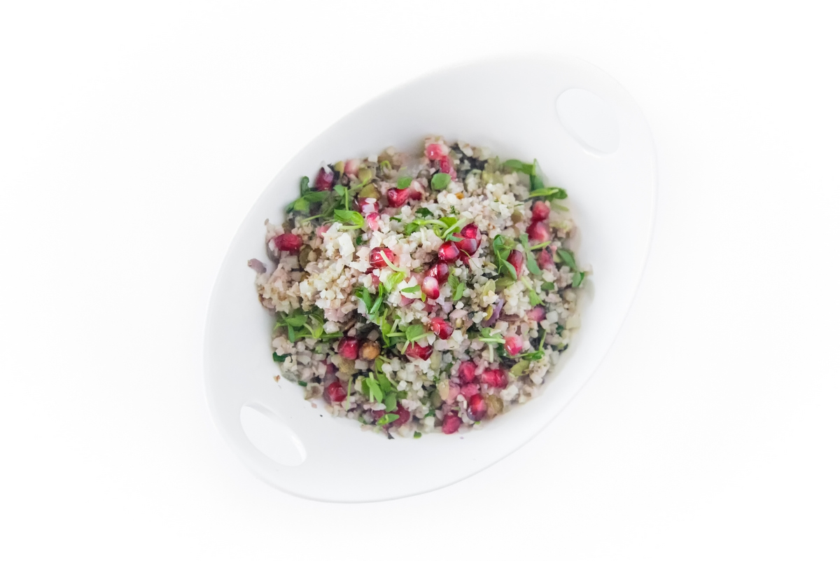 Lebanese Cauliflower Rice with Pomegranate Seeds is a beautifully colorful, jeweled cauliflower rice recipe.  The bursts of flavors from the mixed nuts, seeds, dried fruits, and pomegranate are an utter delight. BTW can dogs eat pizza?