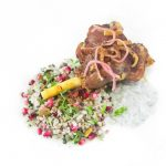 Lebanese Cauliflower Rice with Pomegranate Seeds is a beautifully colorful, jeweled cauliflower rice recipe.  Served with Easy Middle Eastern Braised Lamb Shanks [Keto] and Sumac Onions